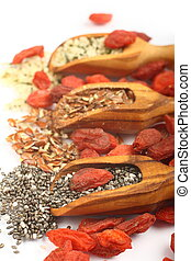 Superfoods in wooden scoops, one of the superfoods seeds of...