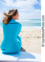 Surfer girl - Blonde girl with a surf board on the beach