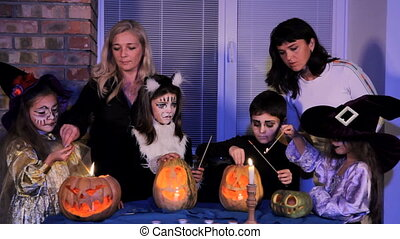 Group of Children And Adults Light Halloween Candles - Two...