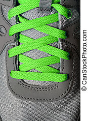 Green Shoe Laces on Running Shoes - Detail of green shoe...