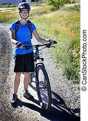 Woman Mountain Biking Wearing Blue Shirt