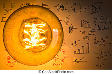 Top view of vintage glowing light bulb with drawing graph