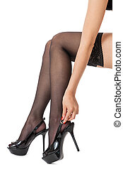Sexy female legs in stilettos and stockings - Sensual...