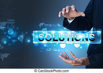 Businessman holding the word solution
