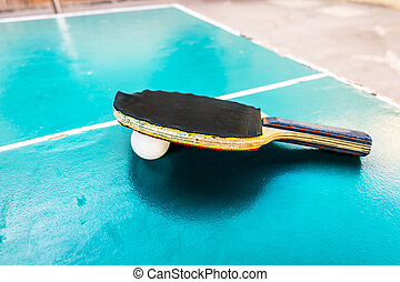 Black Racquet and ball tables tennis balls lay on a wooden...