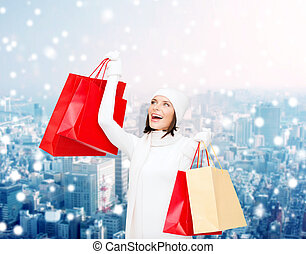 smiling young woman with red shopping bags - happiness,...