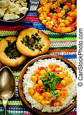 rice with curry chickpeas with vegetables and Arabic flat...