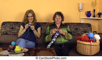 knit in nursing home - Old grandmother knit with young nurse...