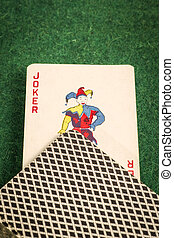 Deck of Cards with Joker on Green