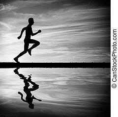 Silhouette of running man against sky. Silhouette of man running