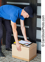 Delivery man putting down parcel - Delivery guy leaving a...