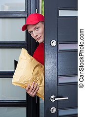 Delivery man at the doorstep