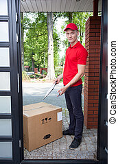 Delivery man with a big box - Delivery guy leaving a large...
