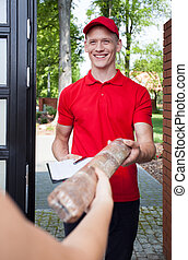 Delivery man handing in package