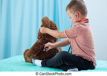 Child playing at doctor