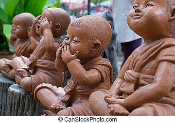 Clay Monk Happy Statues