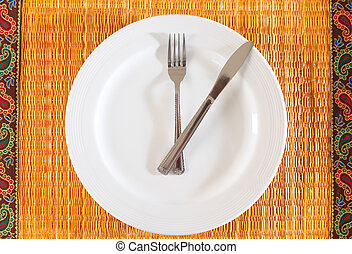 Mealtime concept - Empty plate with utensils marking hour