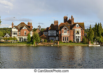old houses and a white canoe over river Thames, Marlow - old...