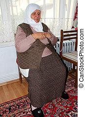 photo of praying turkish old wman
