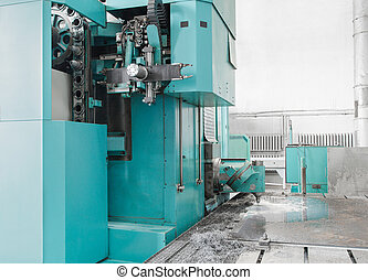 Milling Machine with automatic interchangeable milling heads