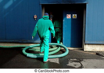 Two industrial workers entering the building - Two...