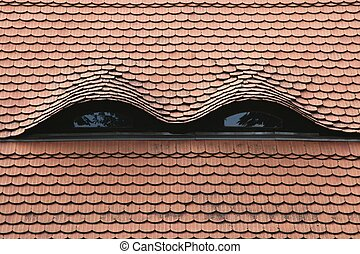 Skylights in a tiled roof.