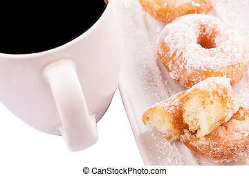 Coffee and Doughnut - A mug of coffee and homemade doughnut...