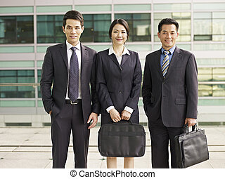 asian business team - portrait of an asian business team.