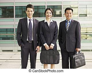 asian business team - portrait of an asian business team