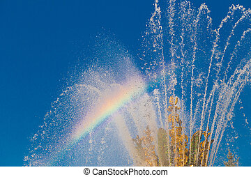 refraction of light in the spray of the fountain and colored...