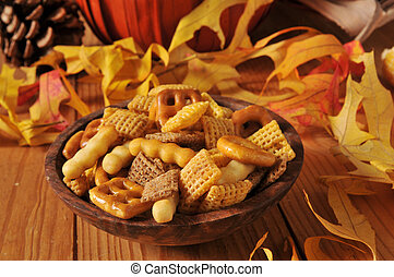 Party snack food - A wooden bowl of party snack food on a...