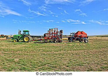 Farm Machinery - Machinery lined up ready to plant. Tractor,...