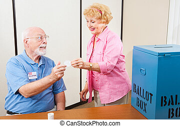 Polling Volunteer and Voter - Volunteer gives an I Voted...