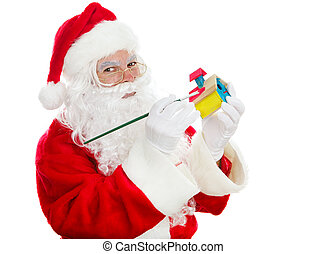 Santas Christmas Toy Shop - Santa painting a child's toy for...