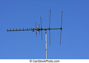 Household television aerial against blue sky