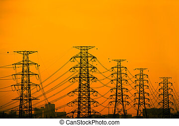 High voltage towers aganist the sunset background.