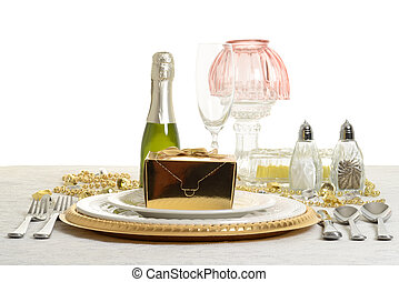 table setting with gold gift