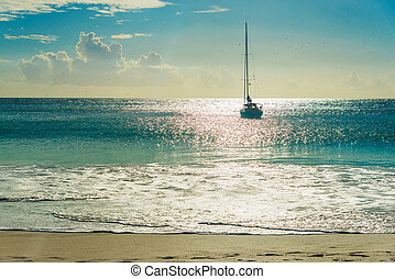 Yacht at tropical beach at sunset. Anse Georgette, Praslin...