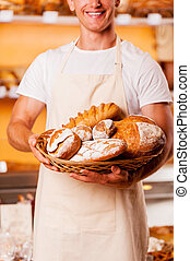 The best baked goods in town Cropped image of young man in...