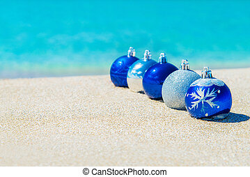 Christmas tree decorations on sea sandy beach - Christmas...