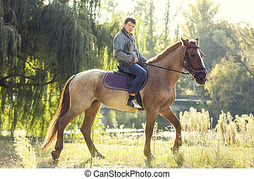 horseback riding - horse ride young guy autumn forest
