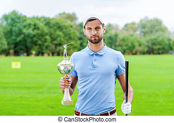 Confident winner. Confident golfer holding golf ball and...