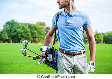 Golf is a style of living Cropped image of male golfer...