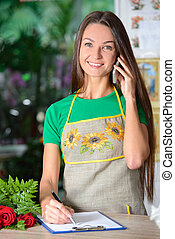 Florists - Beautiful florist at work Beautiful young female...