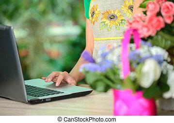 Florists - Portrait of an attractive florist business woman...
