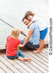 Spending great time together Happy father fishing with his...