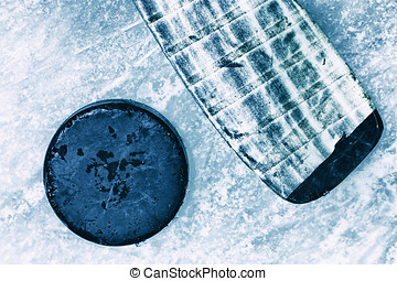 Hockey Stick and Puck Surface of Outdoor Ice Rink Replete...