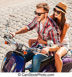 Young and free Top view of beautiful young couple riding...