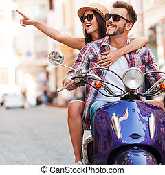 Just look at that Beautiful young couple riding scooter...