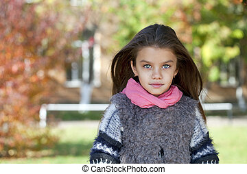Beautifal little girl in the autumn park